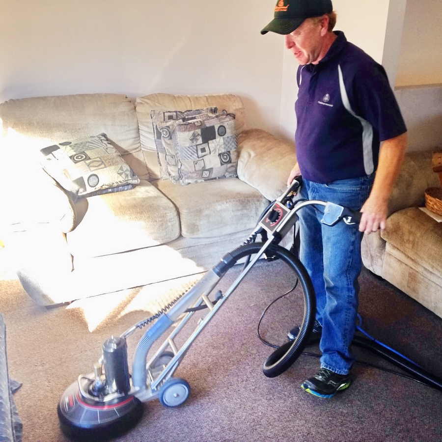 Owner working on a carpet with Rotovac Industrial Cleaner